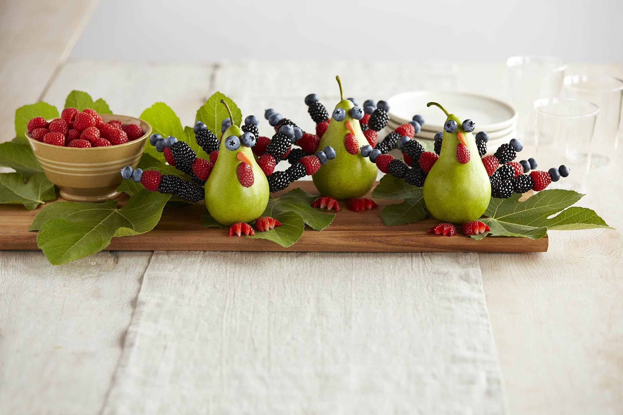 Turkeys made out of pears and berries