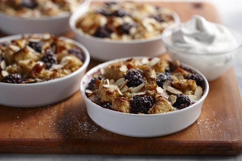 Cups of blackberry almond bread pudding