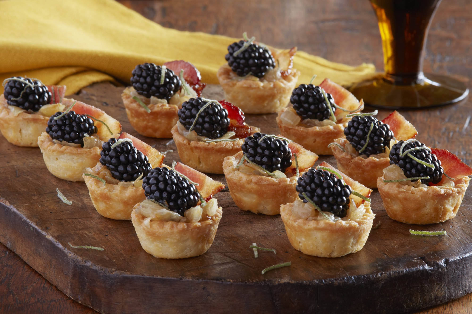 Small blackberry and bacon caramelized onion tartlets