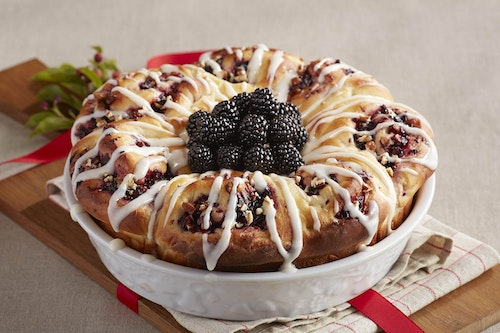 A bowl with blackberry pecan cinnamon rolls